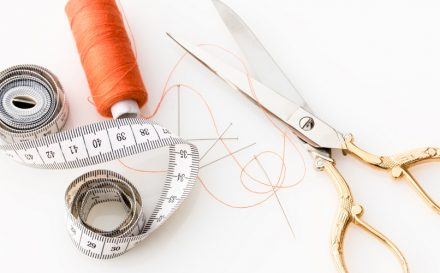 scissors and spool of thread